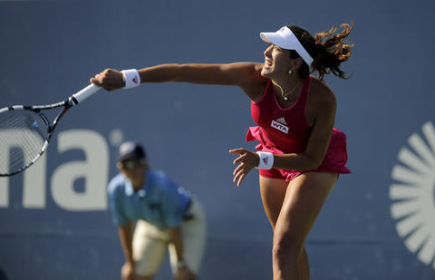 Garbine Muguruza (ESP) serves to Shuai Peng (CHN) during the third set on day four of the 2014 Connecticut Open Tennis Tournament at the Connecticut Tennis Center on the Yale campus in New Haven Wednesday afternoon. Muguruza advanced with a 6-2, 3-6, 6-3 win.