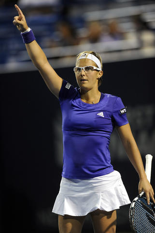 After 3 hrs and 11 minutes Kirsten Flipkens (BEL) points to the sky after defeating Andrea Petkovic (GER) in three sets 4-6, 7-6(4), 7-6(6) on day four of the 2014 Connecticut Open Tennis Tournament at the Connecticut Tennis Center on the Yale campus in New Haven Wednesday evening.