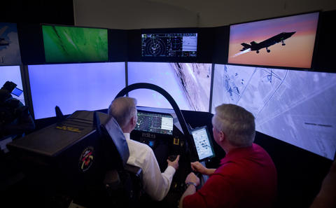 U.S. Representative Randy Forbes gets a first hand look at what it's like the fly an F-35 Lightening II, as he flys a simulator for the aircraft under the watchful eye of F-35 instructor pilot Tony Stutts inside the Center of Aviation, Lockheed Martin in Suffolk.