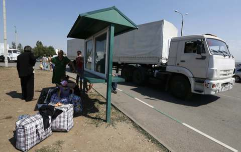 "Trucks of a Russian convoy carrying humanitarian aid for Ukraine drive onto the territory of Russia-Ukraine border crossing point ""Donetsk."""