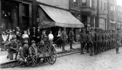 Troops gather at 47th Street and Wentworth Avenue during the Chicago race riots in 1919.