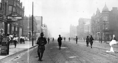 The state run militia patrols the streets of Chicago during the race riot of 1919. Photo dated Aug. 1, 1919.