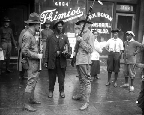Soldiers from the state militia talk with a man during the Chicago race riots of 1919.