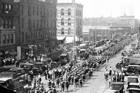 The state militia march through Chicago during the 1919 race riots.