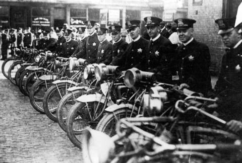 Heavily armed motorcycle and foot policemen stood at the ready for instant transportation to quell the rioting on Chicago's south side on July 30, 1919.