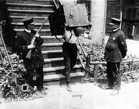 A black resident of the south side moves his belongings to a safety zone under police protection during the Chicago race riots of 1919.