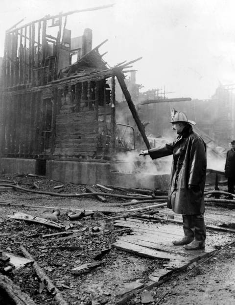 A firefighter looks over a burned out building during the Chicago race riots of 1919.