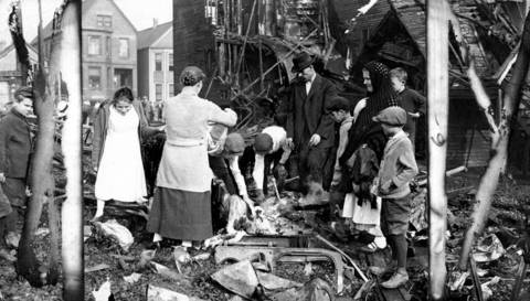 People look over the remains of a destroyed building in the Stock Yards neighborhood during the 1919 Chicago race riots. Photo dated Aug. 2, 1919.