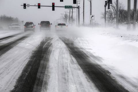 Blizzard-like conditions make driving treacherous along Harlem Avenue in Frankfort.