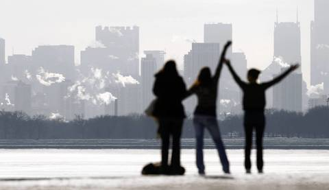 Christine Welk, of Gahanna, Ohio, from left, and her two brave daughters Sarah Welk, 24, and Hannah Welk, 19, venture into the cold at Montrose Harbor for a photograph during their Christmas visit with family in the area.