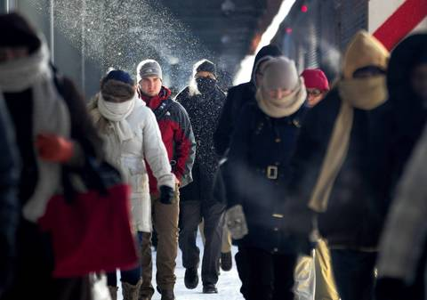 Metra commuters brave the subzero temperatures as they arrive at the LaSalle Street station in Chicago.