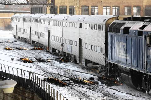 The railroad interlockings with gas powered heaters to melt the snow, at the Metra Milwaukee Western Avenue station.