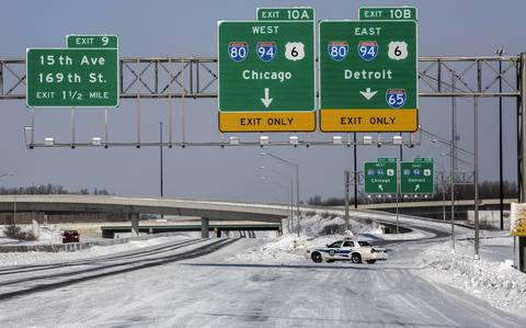 An Indiana State Police trooper blocks entrance to I-80/95 at Cline Avenue in Hammond as temperature register -13F in on Monday.
