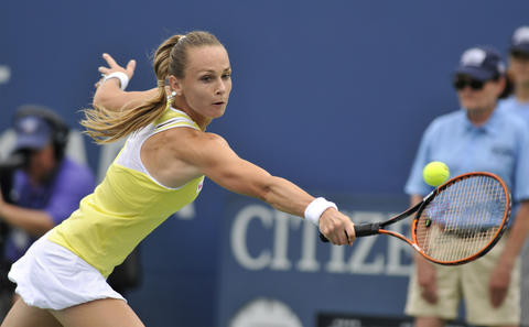 New Haven, CT - 08/22/14 - Magdalena Rybarikova lunges for a backhand against Camila Giorgi, who she defeated in straight sets (6-2, 6-4) in Friday's first women's semifinal of the Connecticut Open. Photo by BRAD HORRIGAN | bhorrigan@courant.com