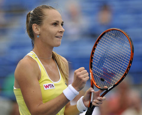 New Haven, CT - 08/22/14 - Magdalena Rybarikova reacts after defeating Camila Giorgi in straight sets (6-2, 6-4) in Friday's first women's semifinal of the Connecticut Open. Photo by BRAD HORRIGAN | bhorrigan@courant.com