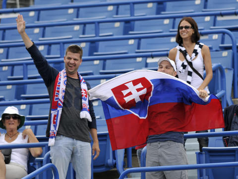 New Haven, CT - 08/22/14 - Slovak supporters cheer on Magdalena Rybarikova against Camila Giorgi in Friday's first women's semifinal of the Connecticut Open. Photo by BRAD HORRIGAN | bhorrigan@courant.com