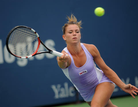 New Haven, CT - 08/22/14 - Camila Giorgi hits a forehand against Magdalena Rybarikova in Friday's first women's semifinal of the Connecticut Open. Giorgi lost in straight sets (6-2, 6-4). Photo by BRAD HORRIGAN | bhorrigan@courant.com