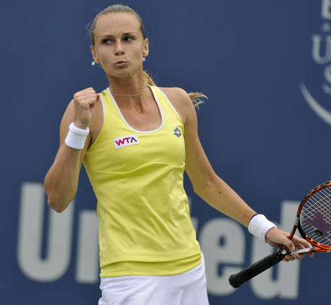 New Haven, CT - 08/22/14 - Magdalena Rybarikova reacts after scoring a point against Camila Giorgi. Rybarikova defeated the Italian in straight sets (6-2, 6-4) in Friday's first women's semifinal of the Connecticut Open. Photo by BRAD HORRIGAN | bhorrigan@courant.com