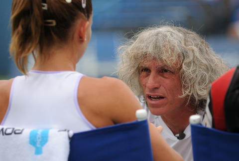 New Haven, CT - 08/22/14 - Camila Giorgi's father and coach Sergio Giorgi has a word with her during Friday's first women's semifinal of the Connecticut Open. Photo by BRAD HORRIGAN | bhorrigan@courant.com
