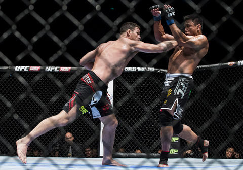 Michael Bisping (L) of England punches Cung Le of USA during their 5-Round middleweight fight against during the UFC Fight Night at The Venetian Macao Cotai Arena on August 23, 2014 in Macau, China.
