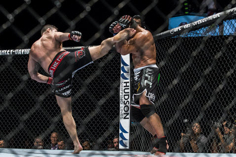 Michael Bisping (L) of England kicks on Cung Le of USA during their 5-Round middleweight fight against during the UFC Fight Night at The Venetian Macao Cotai Arena on August 23, 2014 in Macau, China.
