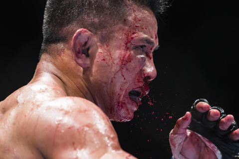 Cung Le of USA bleeds on his 5-Round middleweight fight against Michael Bisping of England during the UFC Fight Night at The Venetian Macao Cotai Arena on August 23, 2014 in Macau, China.