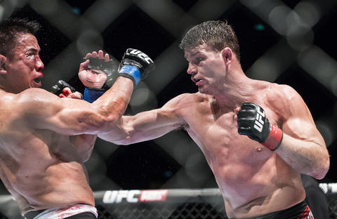Michael Bisping (R) of England punches Cung Le of USA during their 5-Round middleweight fight during the UFC Fight Night at The Venetian Macao Cotai Arena on August 23, 2014 in Macau, China.