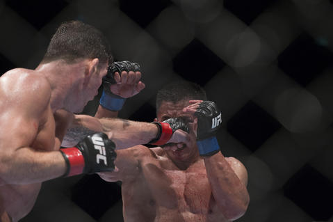 Michael Bisping (L) of England punches Cung Le of USA during their 5-Round middleweight fight during the UFC Fight Night at The Venetian Macao Cotai Arena on August 23, 2014 in Macau, China.