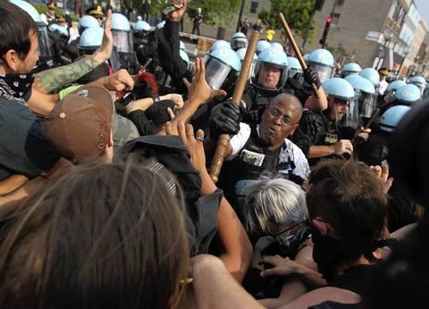 Lt. Glenn Evans fends off protesters.