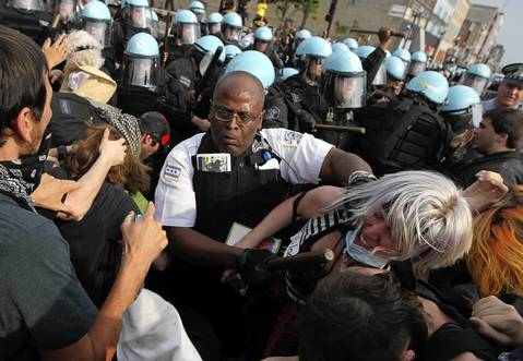 Chicago Police Lt. Glenn Evans wades into the protesters.