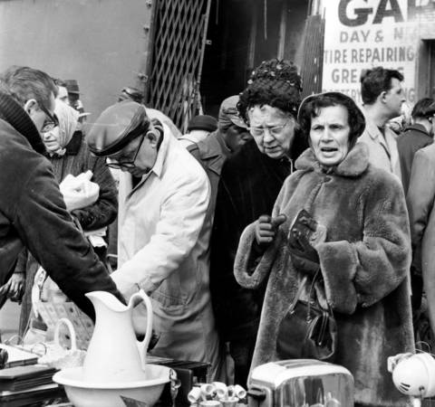 Crowds gather at the Maxwell Street market, circa March 24, 1964.