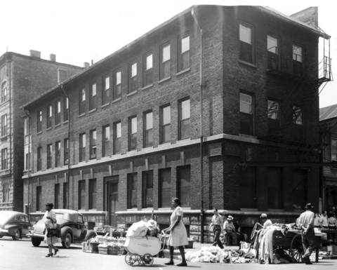 In June 1944, the Chicago Maternity Center on the corner of Maxwell Street and Newberry Avenue was surrounded by the open-air market.
