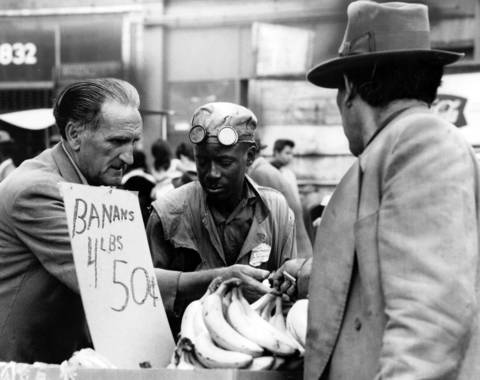 Just because the sign says bananas are 50 cents for 4 pounds doesn't mean a purchase on the Maxwell Street open market will be without its bargaining on Sept. 20, 1966. Editors note: The sign in this print has been partially hand painted.