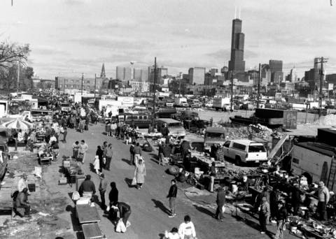 "Sunday, Oct. 30, 1988, proved to be a typically busy day at the Maxwell Street market. ""It's one of the most fascinating real estate submarkets in the city right now,"" said Greg Longhini of the city planning department in 1988. The view is looking north on Peoria Street."
