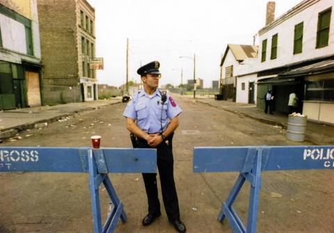 Barricades and security are all that's left of the Maxwell Street market, which closed the week prior after 120 years. University of Illinois Security Guard Zyad Hasan stands near a police barricade where the old market used to be at Maxwell and Halsted Streets in Chicago on Sept. 9, 1994.