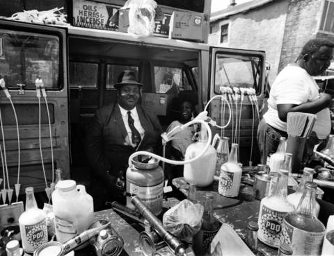 A merchant sells insect spray at Maxwell Street market on Aug. 3, 1969.