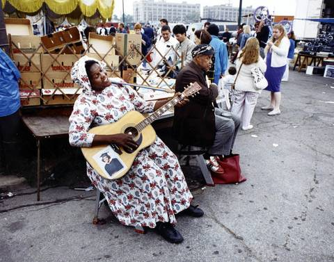 A woman gives a Sunday morning serenade at Maxwell Street and Newberry Avenue in Chicago, circa Oct. 1990.