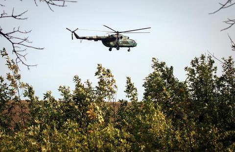 A Ukrainian attack helicopter flies near a military camp in Kramatorsk , near Slaviansk, Ukraine, on Sept. 1.
