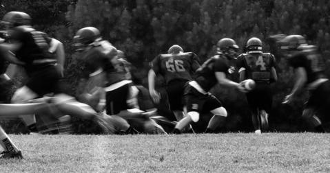 The Tabb High team runs plays during a pre-season practice.