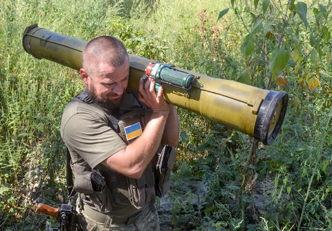 A Ukrainian servicemember from the Kiev-1 Battalion holds a found portable anti-tank guided missile launcher on Sept. 2 in the southeastern Ukrainian town of Slavyansk.