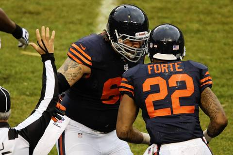 Chicago Bears guard Eben Britton (62) celebrates with Chicago Bears running back Matt Forte (22) after he ran the ball off a short toss from Chicago Bears quarterback Josh McCown (12) in the second quarter.