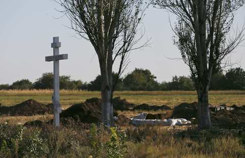 A cross stands at an abandoned Ukranian military position after fighting with pro-Russian separatists outside the village of Mnogopolye, southeast from Donetsk September 5. A ceasefire between Ukrainian forces and pro-Russian separatists in eastern Ukraine appeared to be holding that evening.