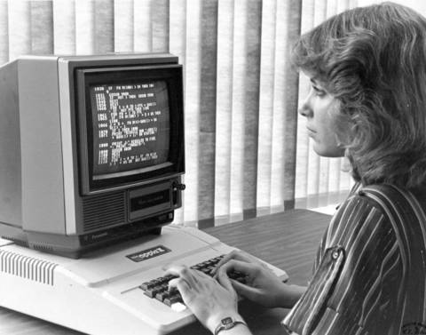 Robin Koch creates a program on an Apple II Plus computer.