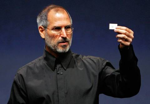 Apple CEO Steve Jobs holds up a new iPod Shuffle as he delivers a keynote address during an Apple media event in San Francisco.