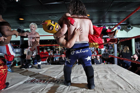 Staff Photo Of The Week: Aug 2-Aug 8, 2014     Wrestlers perform at Cozzy's Comedy Club Wednesday evening.