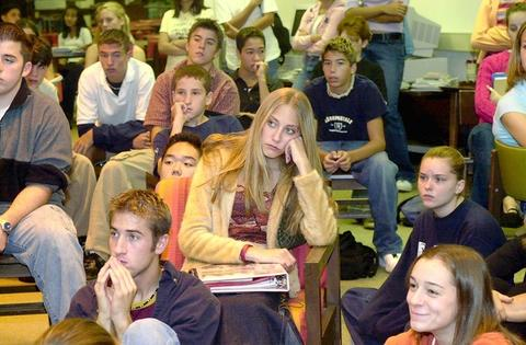 Students at Palatine High School gather to watch news reports of the attack. Many high schools turned on televisions. Some elementary schools only told pupils that people were hurt.