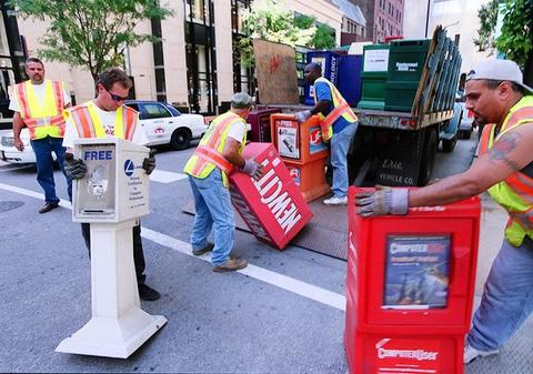 City workers remove newspaper boxes Tuesday on Michigan Avenue next to the Chicago Water Tower. The city secured areas seen as possible targets for terrorism.