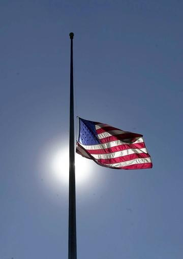 A flag flies at half-staff at O'Hare International Airport in honor of those killed Tuesday in terrorist attacks.