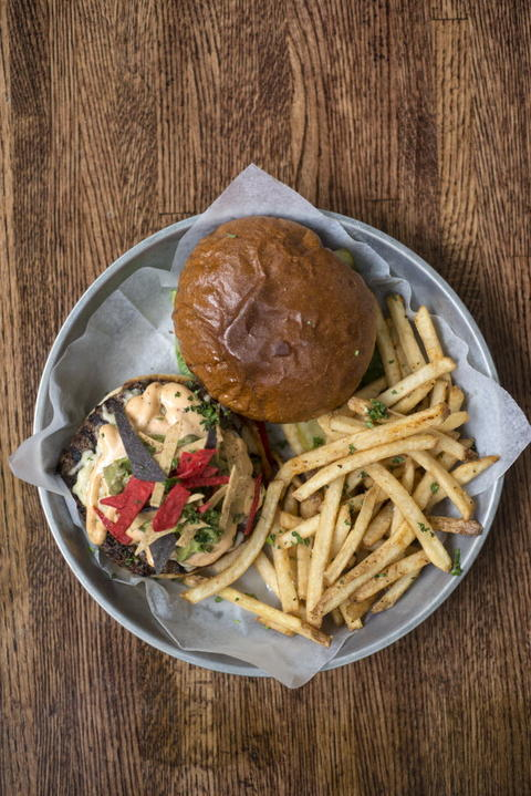 The House burger with Chihuahua cheese, chipotle mayo, guacamole and tortille strips at Whisk Chicago, 2018 W. Chicago Ave. in Ukrainian Village.