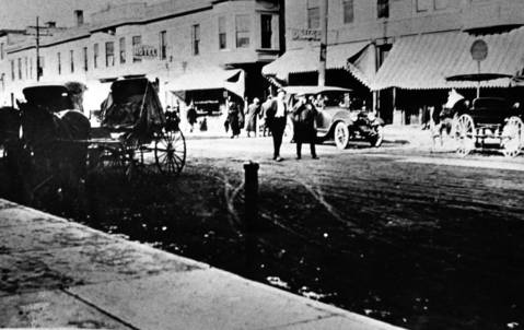 Early-1920s: This photo shows a view of Milwaukee Avenue north of Cook Avenue. Original photo courtesy of the Libertyville-Mundelein Historical Society.